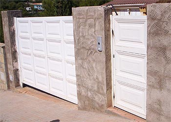 Carpinteria met lica jucar puertas garaje for Puertas de garaje precios